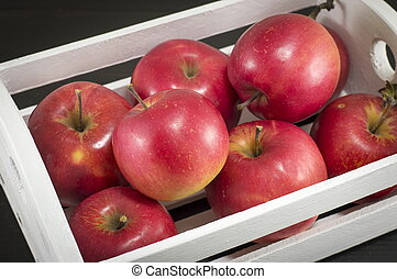 wooden crate full of fresh ripe apples