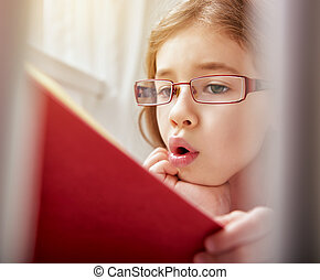 girl reading a book - cute child girl reading a book. self...