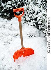 Orange shovel for snow removal - Snow removal. Orange Shovel...