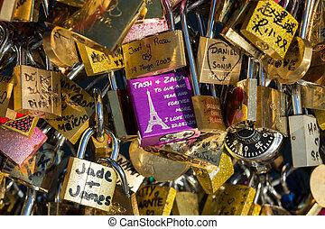 Paris, France - Pont   des Arts. Love padlocks on the bridge.   Passerelle des Arts is a pedestrian bridge in Paris which crosses the River Seine