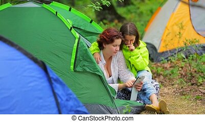 Happy Girls Watching Photos On Smartphone In Tent - This is...