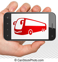 Travel concept: Hand Holding Smartphone with Bus on display...