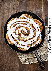 Cinnamon Buns - Freshly baked cinnamon buns in a cast iron...