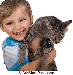 Boy hugging cat - A young boy hugging his cat