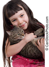 Little girl with her pet - Young girl holding her pet cat.