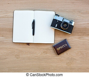 Notepad with pen, camera