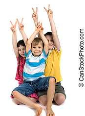 Happy Children Giving Victory Sign - Three happy children...