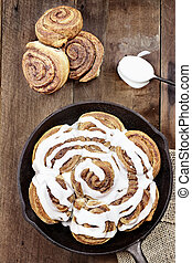 Cinnamon Rolls - Freshly baked cinnamon buns in a cast iron...