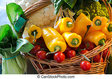 Still life of fresh vegetables and spices on straw mats -...