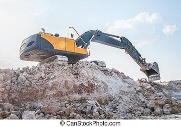 Loader excavator standing in sandpit - loader excavator in...