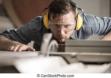 Saw operator preparing ideal board - Horizontal photo of...