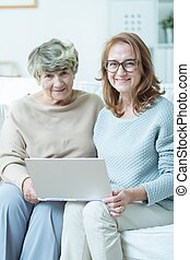 Visit in nursing home - Woman visiting her mother in nursing...