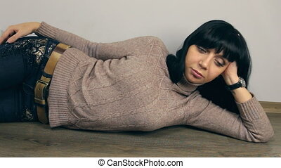 Beautiful girl lying on the floor, trolley dolly, dolly shot