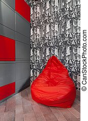 Stylish pouf for teenage room - Photo of stylish red pouf...