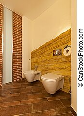 Loft toilet in brown tones - Vertical photo of loft toilet...