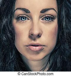 beauty portrait brunette girl with blue eyes