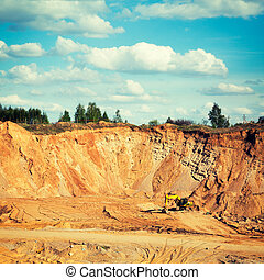Excavator on a Sand Quarry. Heavy Industry Concept. Toned...
