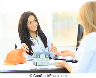 A real estate agent with a model home in the workplace
