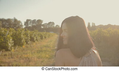 Happy young woman in the vineyards