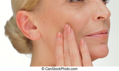 The concept of elasticity of the skin. Portrait of beautiful...