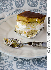 Egg yolk cake and cream served on a plate