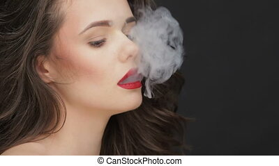 Slow motion concept of harm of smoking. Portrait of...