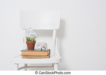 Stylish home decor - Home plant with bell jar, vintage books...