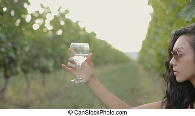 Young woman drinking wine - Young woman drinking a glass of...