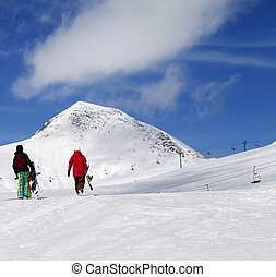 Snowboarders on slope at sun nice day Caucasus Mountains,...