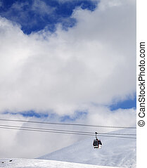 Gondola lift and off-piste slope at sun day Caucasus...