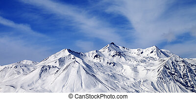 Panoramic view on winter snowy mountains in windy day...
