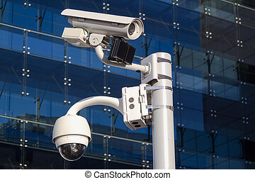 Camera in front of a glass building - Security surveillance...