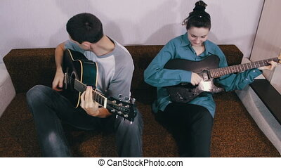 Creative happy couple playing guitar - Cheerful in love...