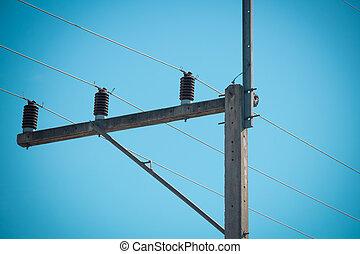 concrete electric pole on blue sky