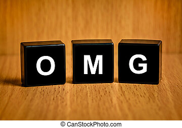 OMG or Oh My God word on black block - OMG or Oh My God text...