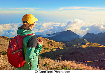 Hiker portrait of young woman hiking in high mountains -...