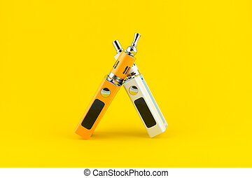 Electronic Cigarette mod closeup on yellow background