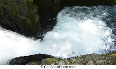 Cascade between the rock walls - Rapid flowing narrow...