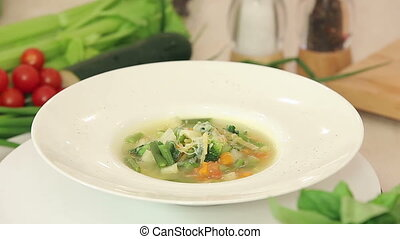 A plate of hot vegetable soup presentation - Presentation of...