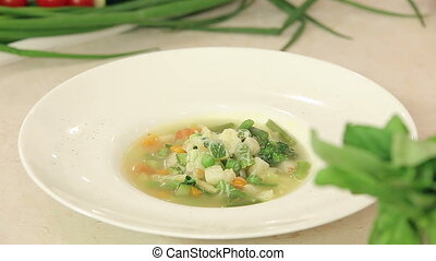 A plate of hot vegetable soup - A plate of hot reeky...