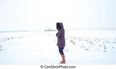 The girl in a field. snowy winter