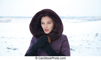Beautiful girl in her cold snowy field