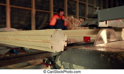 Woodworking. View of conveyor profiled beam, close-up
