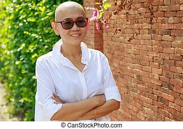 portrait self confidence asian woman with bald head after...