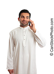 Arab ethnic businessman talking cellphone - A happy ethnic...