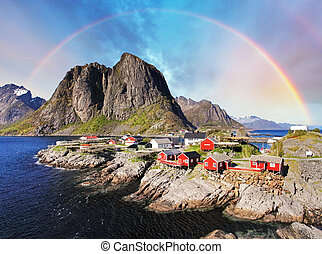 Norwegian fishing village huts with rainbow, Reine, Lofoten...
