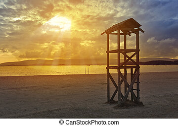 Watchtower at sunset on Compostela beach in Vilagarcia de...