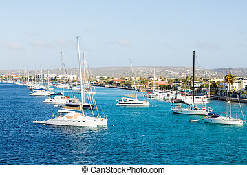 White Yachts Moored in Bonaire - White yachts and sailboats...