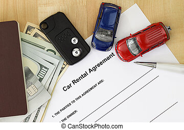 Car rental agreement with car key, passport, cash, credit card