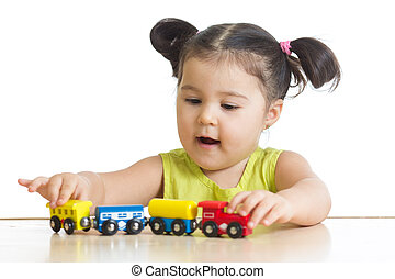 Kid girl playing with train toy